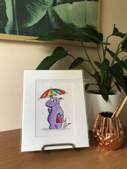 Purple Hippo and umbrella disp[layed on a stand on a desk as display option